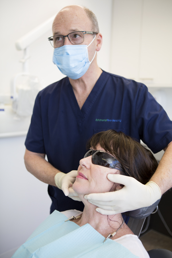 General dentistry in Melbourne with dentist performing an oral cancer check at Bridge Road dentist in Richmond